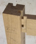 Angled tenon slotted into mortice