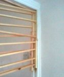 Panelled door - using laths to cramp new stops